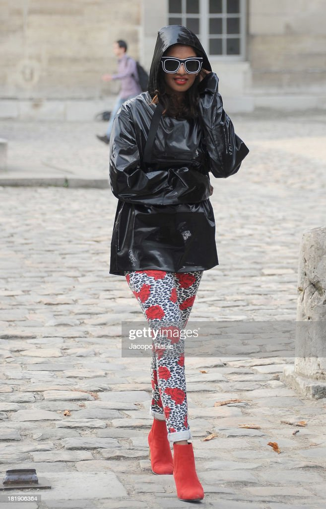 Singer M.I.A. (Maya Arulpragasam) leaves the Balenciaga fashion show during Paris Fashion Week - Womenswear SS14 - Day 3 on September 26, 2013 in Paris, France.
