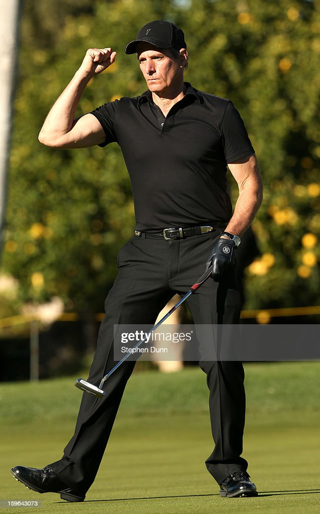 Singer Michael Bolton pumps his fist after making a birdi putt on the 15th hole during the first round of the Humana Challenge in partnership with the Clinton Foundation at La Quinta Country Club on January 17, 2013 in La Quinta, California.