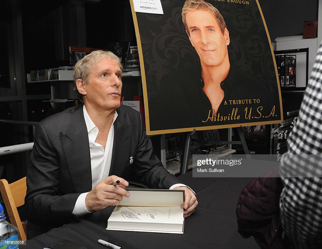 Singer Michael Bolton (L) signs his book following An Evening With Michael Bolton at The GRAMMY Museum on February 12, 2013 in Los Angeles, California.