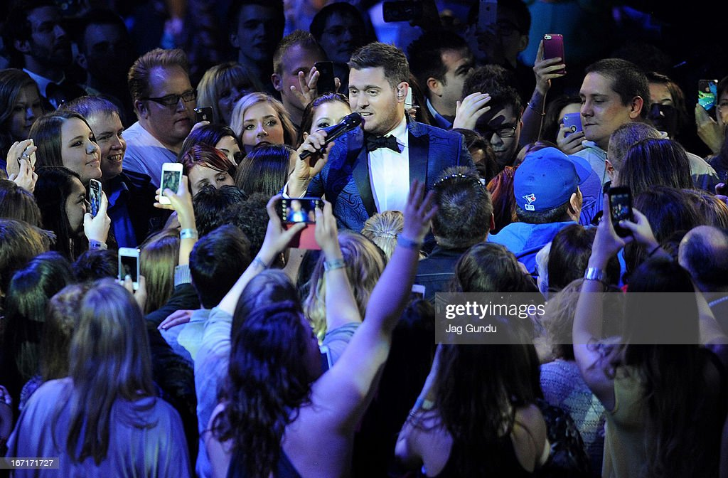 Singer <a gi-track='captionPersonalityLinkClicked' href=/galleries/search?phrase=Michael+Buble&family=editorial&specificpeople=215140 ng-click='$event.stopPropagation()'>Michael Buble</a> performs on stage at the 2013 Juno Awards held at the Brandt Centre on April 21, 2013 in Regina, Canada.