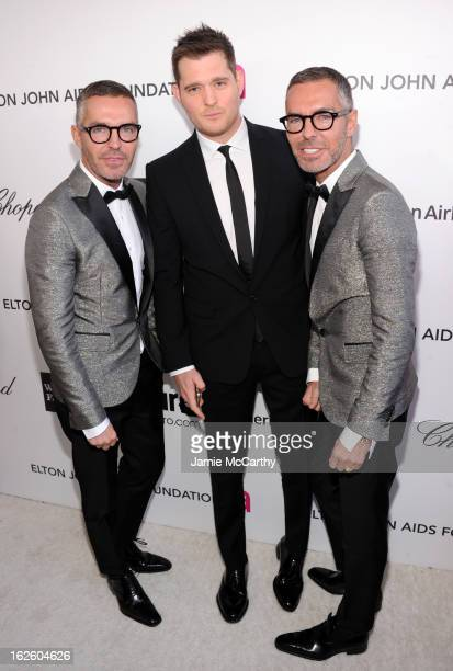Singer Michael Buble with Dean and Dan Caten of DSquared2 attend the 21st Annual Elton John AIDS Foundation Academy Awards Viewing Party at West...