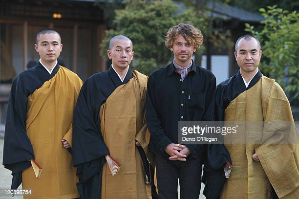 Singer Michael Hutchence of Australian rock group INXS with a group of monks at the Todaiji temple in Nara Japan May 1994 INXS are performing at the...