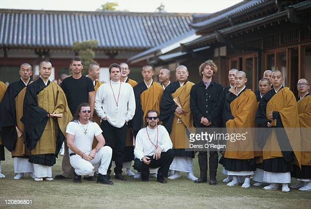 Singer Michael Hutchence with other members of Australian rock group INXS and a group of monks at the Todaiji temple in Nara Japan May 1994 INXS are...