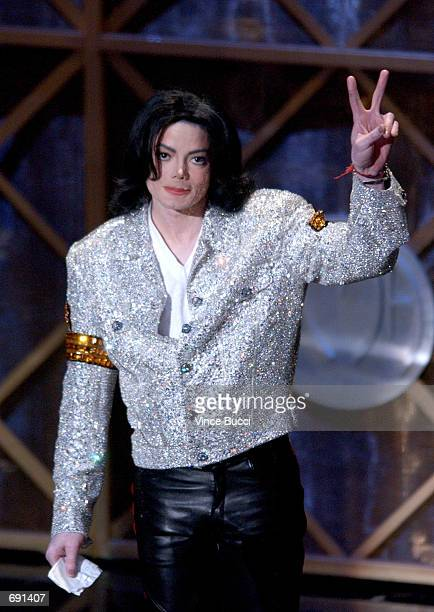 Singer Michael Jackson accepts his Peformer of the Century Award during the 29th Annual American Music Awards at the Shrine Auditorium January 9 2002...