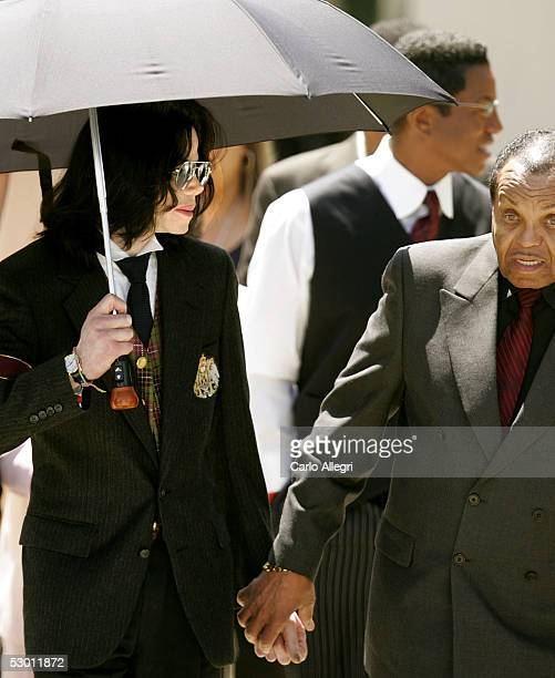 Singer Michael Jackson and his father Joseph Jackson depart courthouse after listening to closing arguements in his child molestation trial at the...