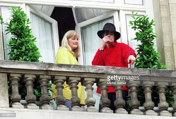 Singer Michael Jackson and his wife Debbie Rowe greet fans from the balcony of the hotel Royal Monceau in Paris 1997 Santa Barbara County Sheriff's...