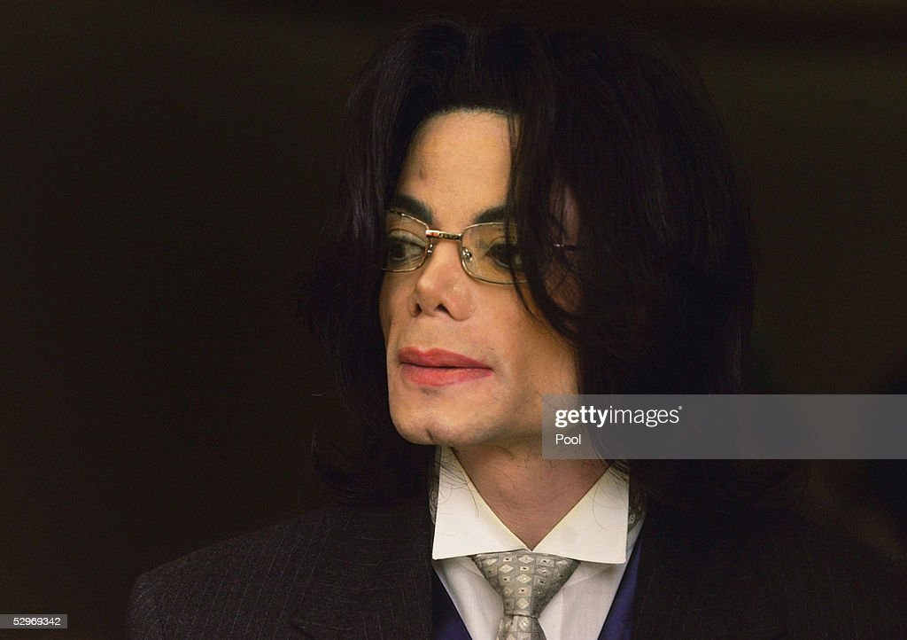 Singer Michael Jackson appears outside the courtroom at the Santa Maria Courthouse during a break in his child molestation trial May 23, 2005 in Santa Maria, California. Jackson is charged in a 10-count indictment with molesting a boy, plying him with liquor and conspiring to commit child abduction, false imprisonment and extortion.