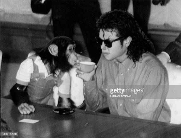 Singer Michael Jackson enjoys a cup of tea with his pet Bubbles at Osaka City Mayoral Hall on September 18 1987 in Osaka Japan