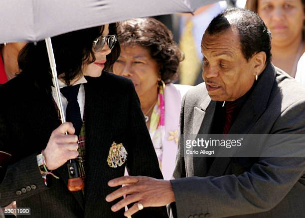 Singer Michael Jackson his mother Katherine Jackson and his father Joseph Jackson depart the courthouse after listening to closing arguements in his...