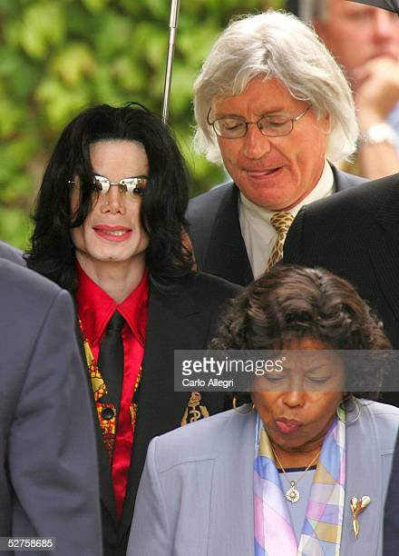 Singer Michael Jackson his mother Katherine Jackson and lead defense attorney Thomas Mesereau Jr depart the Santa Barbara County courthouse on May 4...