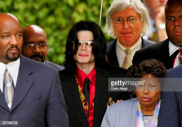 Singer Michael Jackson his mother Katherine Jackson and lead defense attorney Thomas Mesereau Jr depart the Santa Barbara County courthouse...