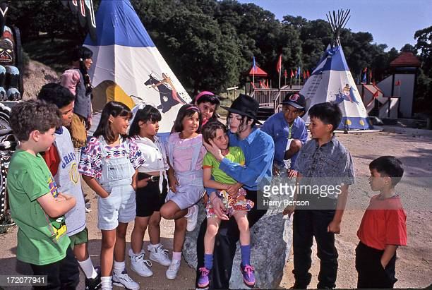 Singer Michael Jackson is photographed with the children of his staff for Life Magazine in 1993 in TeePee Village at Neverland Ranch in Santa Barbara...