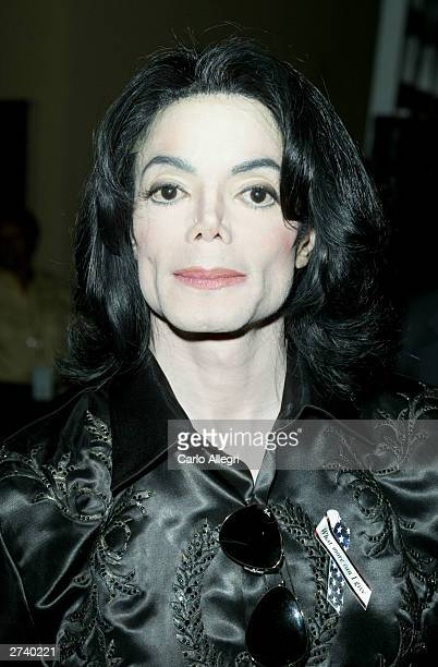 Singer Michael Jackson poses backstage at the 2003 Radio Music Awards at the Aladdin Casino Resort October 27 2003 in Las Vegas Nevada Police armed...