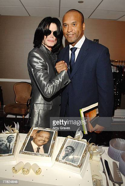 Singer Michael Jackson poses with L Londell McMillan at the VIP Cocktail Reception hosted by Bombay Sapphire at Reverend Jesse Jackson's 66th...