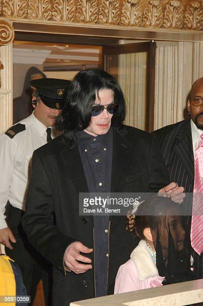 Singer Michael Jackson walks with his daughter Paris as they visit Harrods October 12 2005 in London England