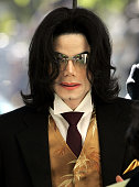 Singer Michael Jackson waves to his supporters as he arrives outside the Santa Barbara County Courthouse for his child molestation trial May 12 2005...