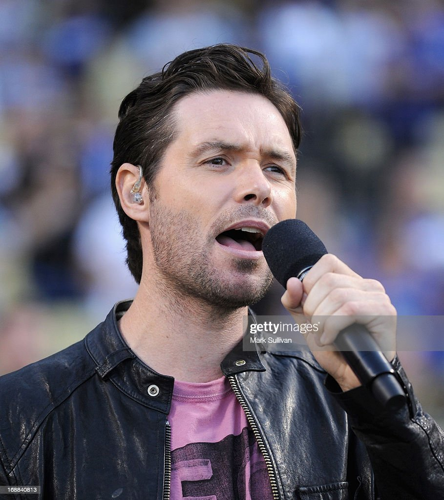 Singer <a gi-track='captionPersonalityLinkClicked' href=/galleries/search?phrase=Michael+Johns&family=editorial&specificpeople=4897964 ng-click='$event.stopPropagation()'>Michael Johns</a> sings the national anthem before the MLB game between the Los Angeles Dodgers and Washington Nationals at Dodger Stadium on May 15, 2013 in Los Angeles, California.