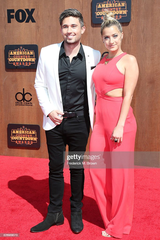 Singer Michael Ray (L) and Carli Manchaca attend the 2016 American Country Countdown Awards at The Forum on May 1, 2016 in Inglewood, California.