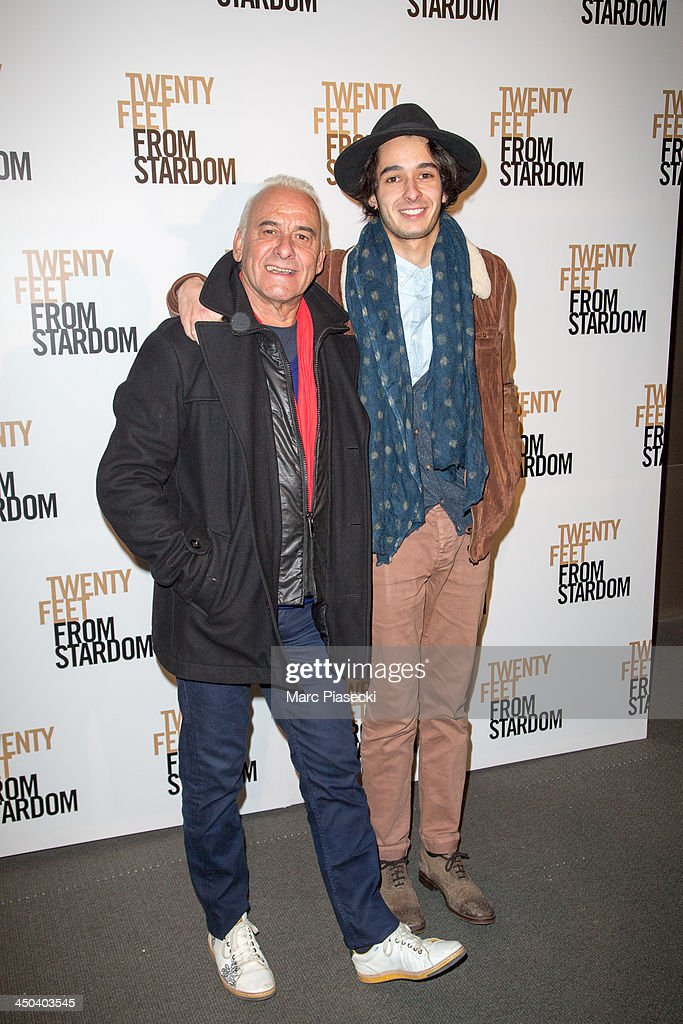 Singer <a gi-track='captionPersonalityLinkClicked' href=/galleries/search?phrase=Michel+Fugain&family=editorial&specificpeople=2040613 ng-click='$event.stopPropagation()'>Michel Fugain</a> and his son attend the 'Twenty feet from stardom' Paris premiere at Cinema UGC Normandie on November 18, 2013 in Paris, France.