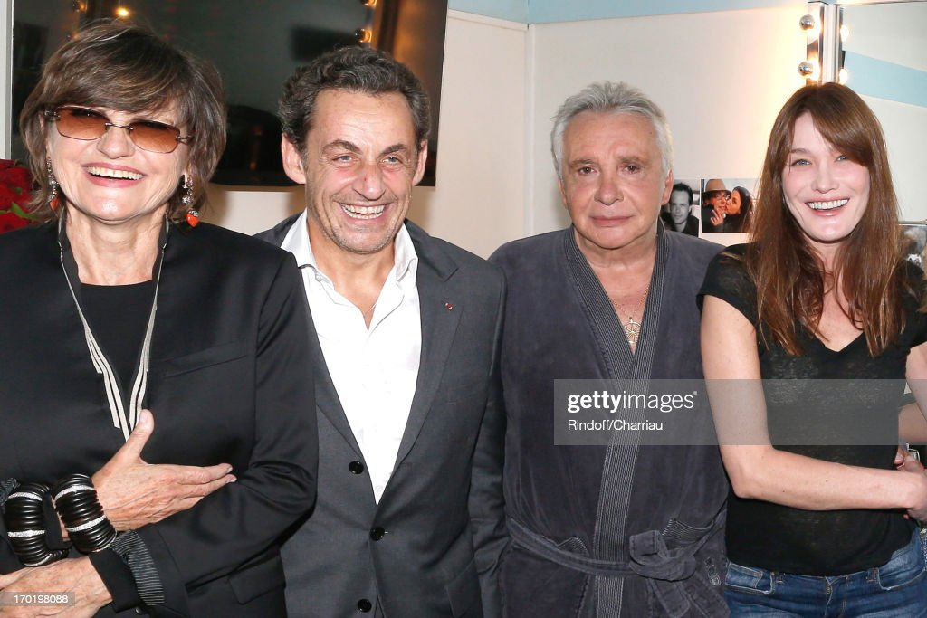 Singer <a gi-track='captionPersonalityLinkClicked' href=/galleries/search?phrase=Michel+Sardou&family=editorial&specificpeople=775626 ng-click='$event.stopPropagation()'>Michel Sardou</a> (2rd R) with his wife Anne-Marie Perier (1st L), Former french President Nicolas Sarkozy (2nd L) with his wife singer <a gi-track='captionPersonalityLinkClicked' href=/galleries/search?phrase=Carla+Bruni&family=editorial&specificpeople=235729 ng-click='$event.stopPropagation()'>Carla Bruni</a> (1st R) backstage at <a gi-track='captionPersonalityLinkClicked' href=/galleries/search?phrase=Michel+Sardou&family=editorial&specificpeople=775626 ng-click='$event.stopPropagation()'>Michel Sardou</a>'s concert at L'Olympia on June 7, 2013 in Paris, France.