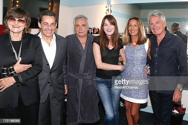 Singer Michel Sardou with his wife AnneMarie Perier Former french President Nicolas Sarkozy with his wife singer Carla Bruni producer Gilbert...