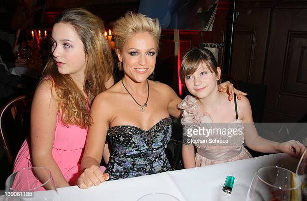 Singer Michelle and her daughters Celine and Mia at her 40th birthday party at Claerchens Ballhaus Auguststrasse 24 on February 15 2012 in Berlin...