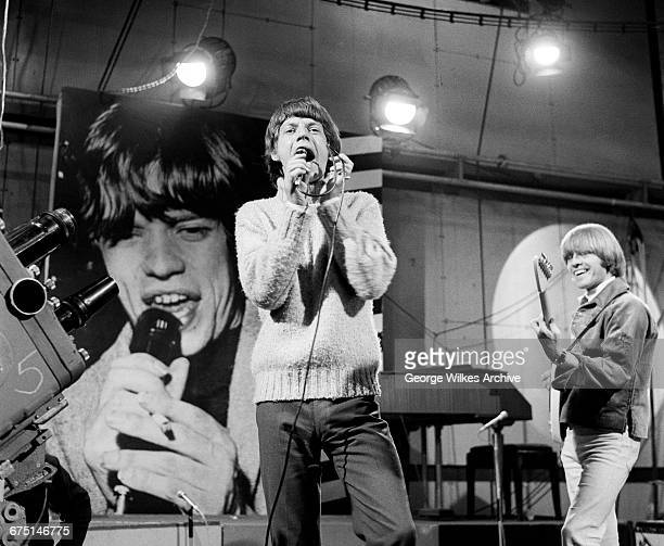 Singer Mick Jagger and guitarist Brian Jones of The Rolling Stones during rehearsals for an episode of the Friday night TV pop/rock show 'Ready...