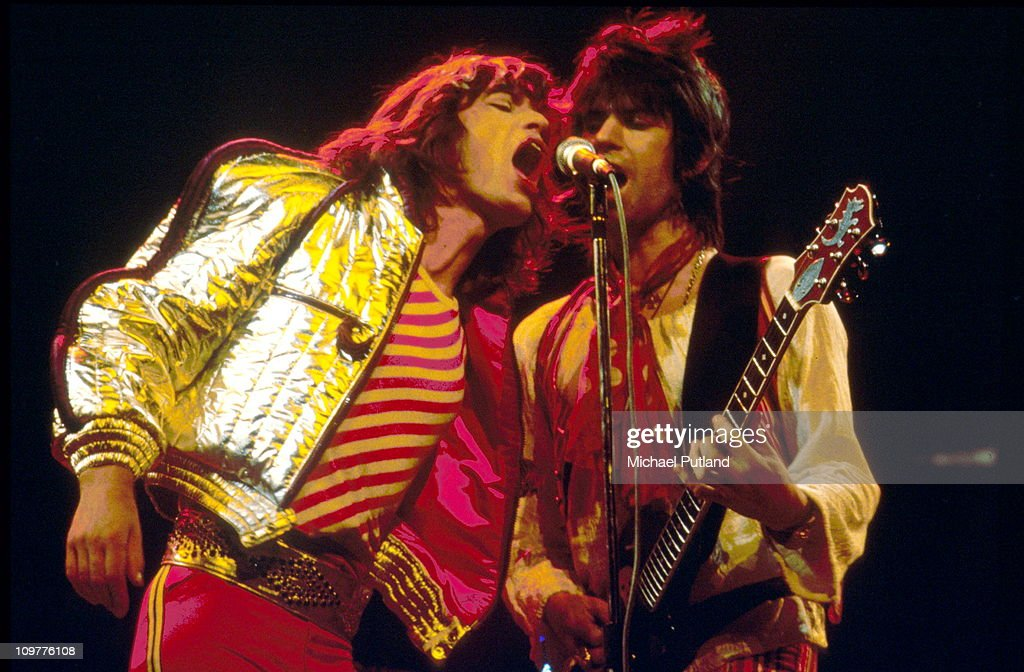 Singer Mick Jagger and guitarist Keith Richards of the Rolling Stones performing on stage at the Festhalle in Frankfurt Germany in April 1976 as part...