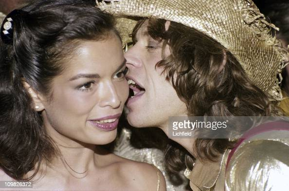 SInger Mick Jagger and his wife Bianca celebrating Colin Tennant's 50th birthday at a party on Mustique 1976