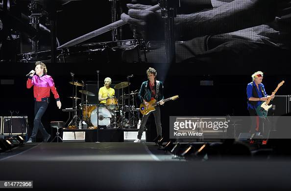 Singer Mick Jagger musicians Charlie Watts Ronnie Wood and Keith Richards of The Rolling Stones perform during Desert Trip at the Empire Polo Field...