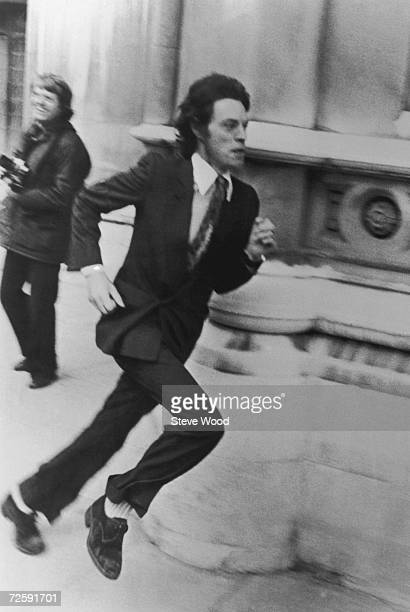 Singer Mick Jagger of the Rolling Stones makes a hasty exit from the High Court in London during his divorce from Bianca Jagger 3rd May 1979