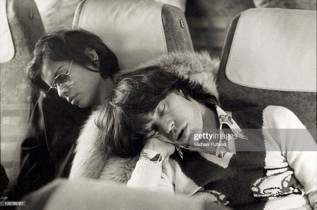 Singer Mick Jagger of the Rolling Stones sleeping alongside his wife Bianca Jagger the morning after the end of their European Tour party in Berlin...