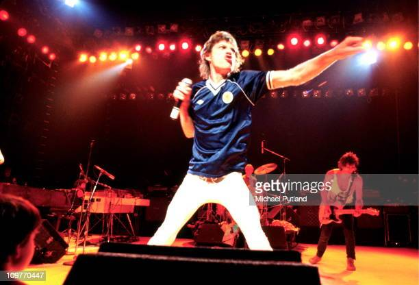 Singer Mick Jagger of the Rolling Stones wearing a Scotland football shirt performing on stage in May 1982