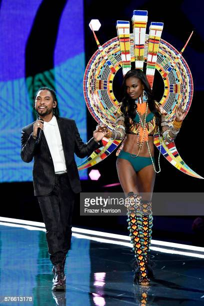 Singer Miguel and model Leomie Anderson walk the runway during the 2017 Victoria's Secret Fashion Show In Shanghai at MercedesBenz Arena on November...