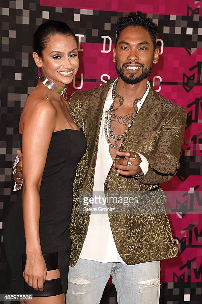 Singer Miguel and model Nazanin Mandi attend the 2015 MTV Video Music Awards at Microsoft Theater on August 30 2015 in Los Angeles California