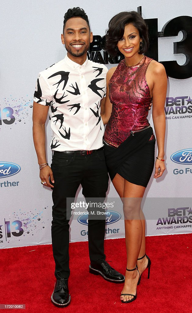 Singer Miguel (L) and Nazanin Mandi attend the 2013 BET Awards at Nokia Theatre L.A. Live on June 30, 2013 in Los Angeles, California.