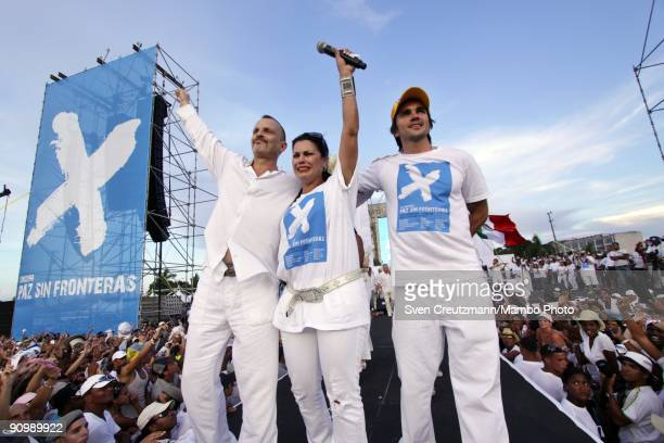 Singer Miguel Bose of Spain Olga Tanon of Puerto Rico and Juanes of Colombia wave to the crowd at the end of the concert for Peace Without Borders...