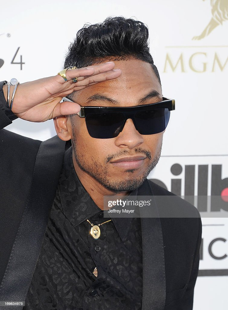 Singer <a gi-track='captionPersonalityLinkClicked' href=/galleries/search?phrase=Miguel+-+Singer&family=editorial&specificpeople=8842866 ng-click='$event.stopPropagation()'>Miguel</a> Jontel Pimentel arrives at the 2013 Billboard Music Awards at the MGM Grand Garden Arena on May 19, 2013 in Las Vegas, Nevada.