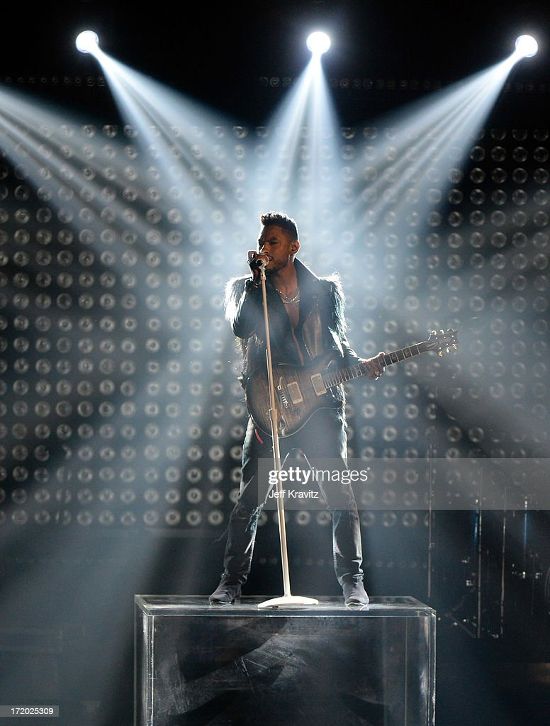 Singer Miguel performs onstage during the 2013 BET Awards at Nokia Theatre L.A. Live on June 30, 2013 in Los Angeles, California.