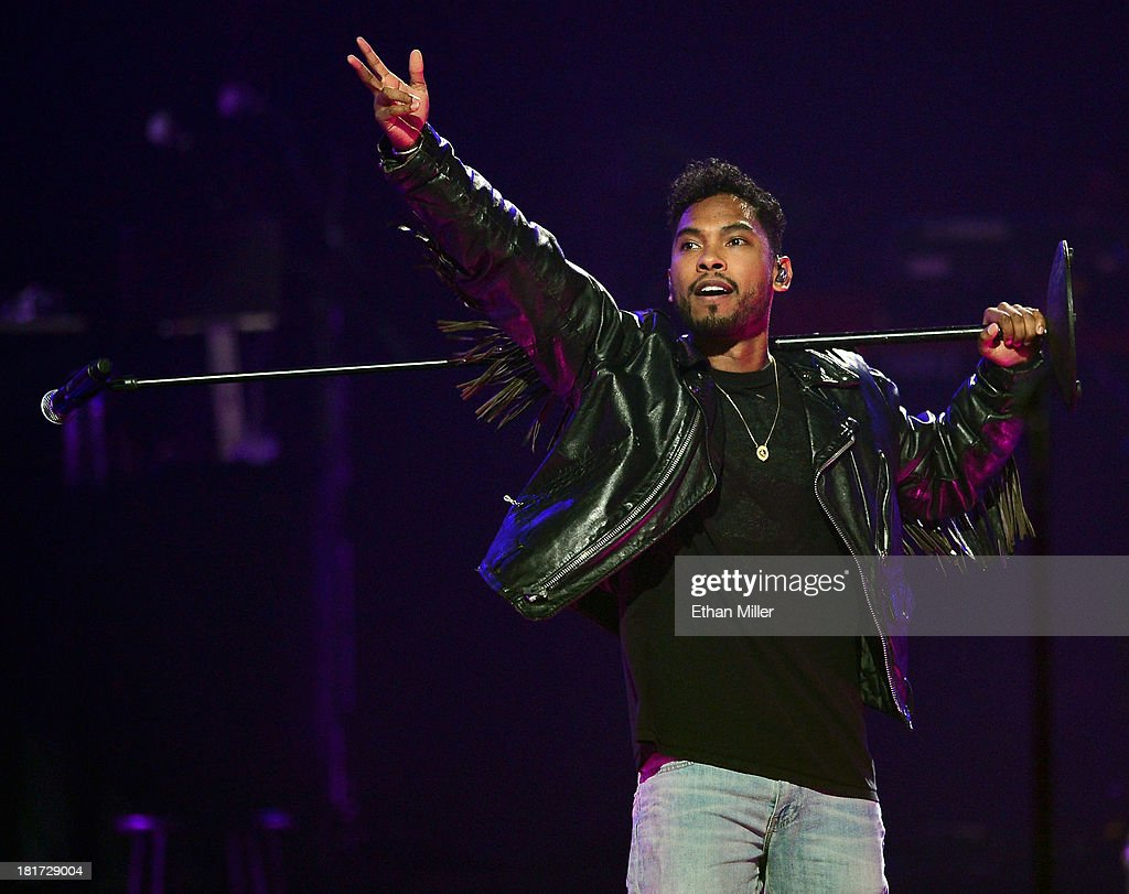 Singer Miguel performs onstage with J. Cole during the iHeartRadio Music Festival at the MGM Grand Garden Arena on September 20, 2013 in Las Vegas, Nevada.