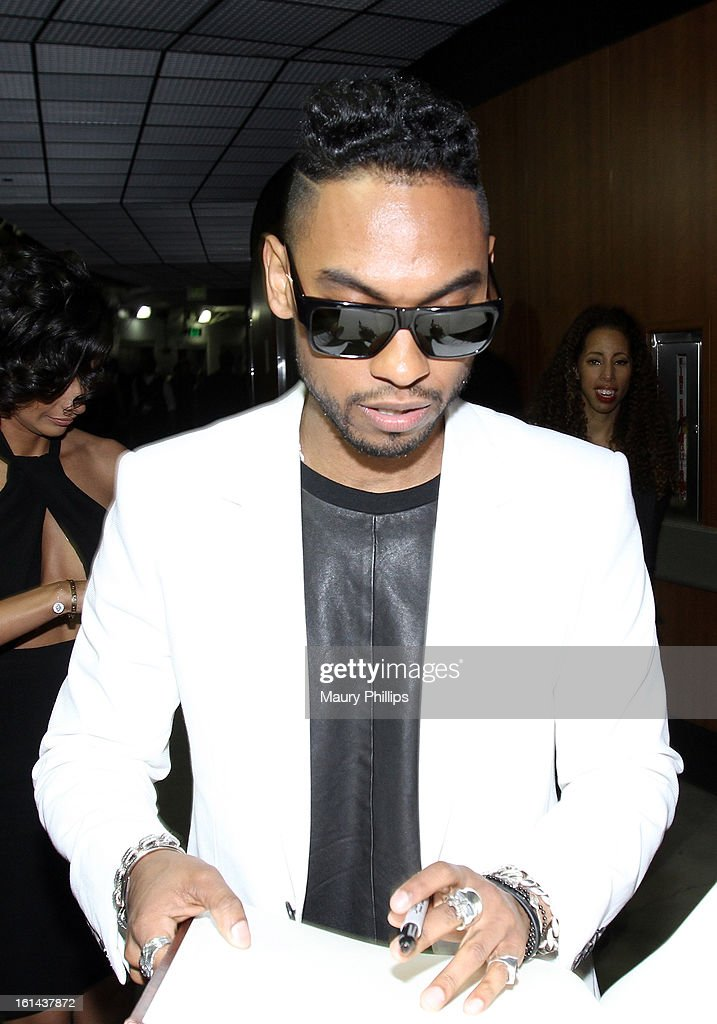 Singer <a gi-track='captionPersonalityLinkClicked' href=/galleries/search?phrase=Miguel+-+Singer&family=editorial&specificpeople=8842866 ng-click='$event.stopPropagation()'>Miguel</a> poses at the GRAMMY Charities Signing Booth during the 55th Annual GRAMMY Awards at STAPLES Center on February 10, 2013 in Los Angeles, California.