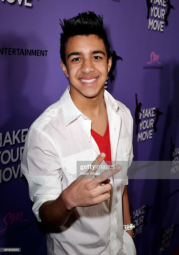 Singer Miguelito arrives at a screening of 'Make Your Move' at The Pacific Theatre at The Grove on March 31, 2014 in Los Angeles, California.
