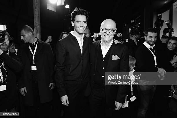 Singer Mika and Swatch Creative Director Carlo Giordanetti attend the Swatch New Flagship Store on November 25 2014 in Milan Italy