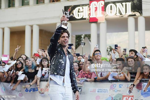 Singer Mika poses with the Giffoni award on July 22 2016 in Giffoni Valle Piana Italy