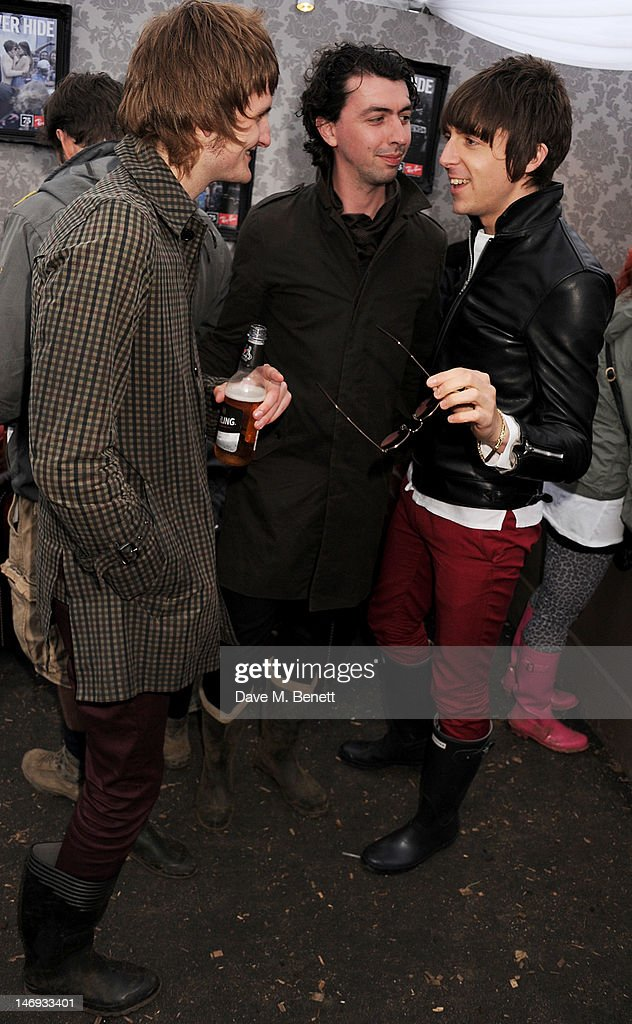 Singer <a gi-track='captionPersonalityLinkClicked' href=/galleries/search?phrase=Miles+Kane&family=editorial&specificpeople=4860678 ng-click='$event.stopPropagation()'>Miles Kane</a> poses with band members Jay Sharrock and Ben Parsons in the Ray-Ban Rooms during day two of the Isle of Wight Festival at Seaclose Park on June 23, 2012 in Newport, Isle of Wight.