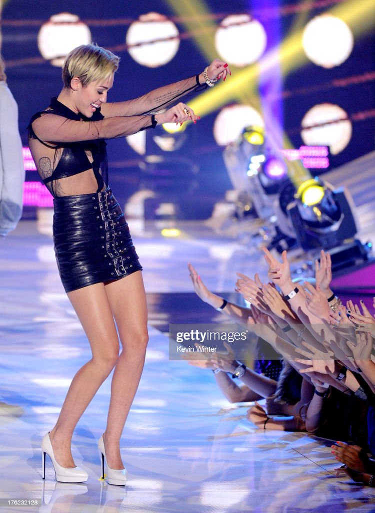 Singer Miley Cyrus accepts the Choice Style Icon award at the Teen Choice Awards 2013 at the Gibson Amphitheatre on August 11, 2013 in Universal City, California.