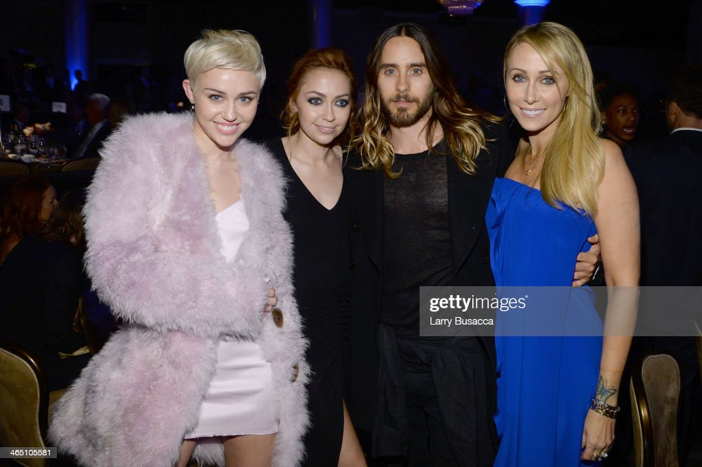 Singer <a gi-track='captionPersonalityLinkClicked' href=/galleries/search?phrase=Miley+Cyrus&family=editorial&specificpeople=3973523 ng-click='$event.stopPropagation()'>Miley Cyrus</a>, actress <a gi-track='captionPersonalityLinkClicked' href=/galleries/search?phrase=Brandi+Cyrus&family=editorial&specificpeople=4375428 ng-click='$event.stopPropagation()'>Brandi Cyrus</a>, actor <a gi-track='captionPersonalityLinkClicked' href=/galleries/search?phrase=Jared+Leto&family=editorial&specificpeople=214764 ng-click='$event.stopPropagation()'>Jared Leto</a> and Tish Cyrus attend the 56th annual GRAMMY Awards Pre-GRAMMY Gala and Salute to Industry Icons honoring Lucian Grainge at The Beverly Hilton on January 25, 2014 in Beverly Hills, California.