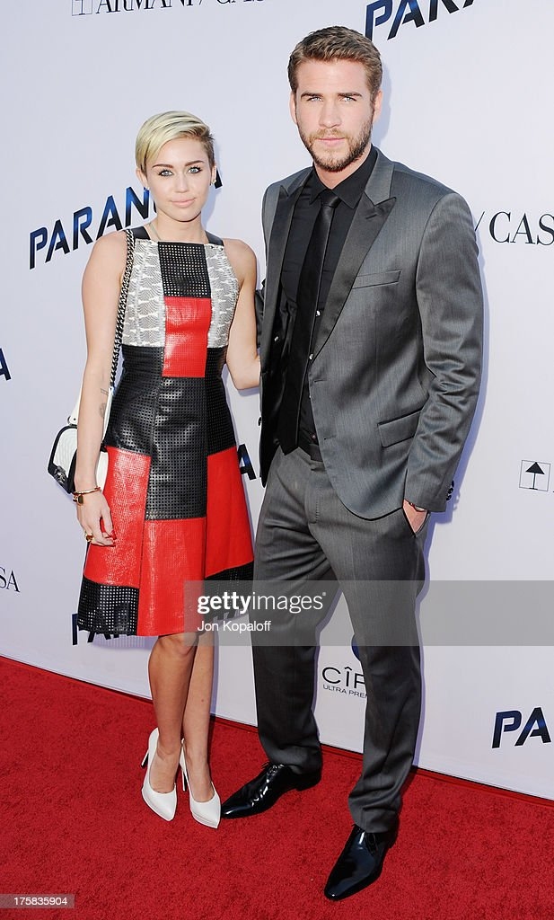 Singer Miley Cyrus and actor Liam Hemsworth arrive at the Los Angeles Premiere 'Paranoia' at DGA Theater on August 8, 2013 in Los Angeles, California.