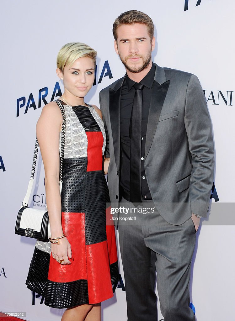 Singer Miley Cyrus and actor Liam Hemsworth arrive at the Los Angeles Premiere 'Paranoia' at DGA Theater on August 8 2013 in Los Angeles California
