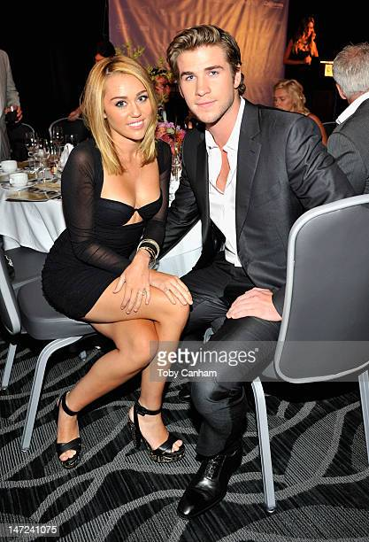Singer Miley Cyrus and actor Liam Hemsworth attend Australians In Film Awards Benefit Dinner at InterContinental Hotel on June 27 2012 in Century...